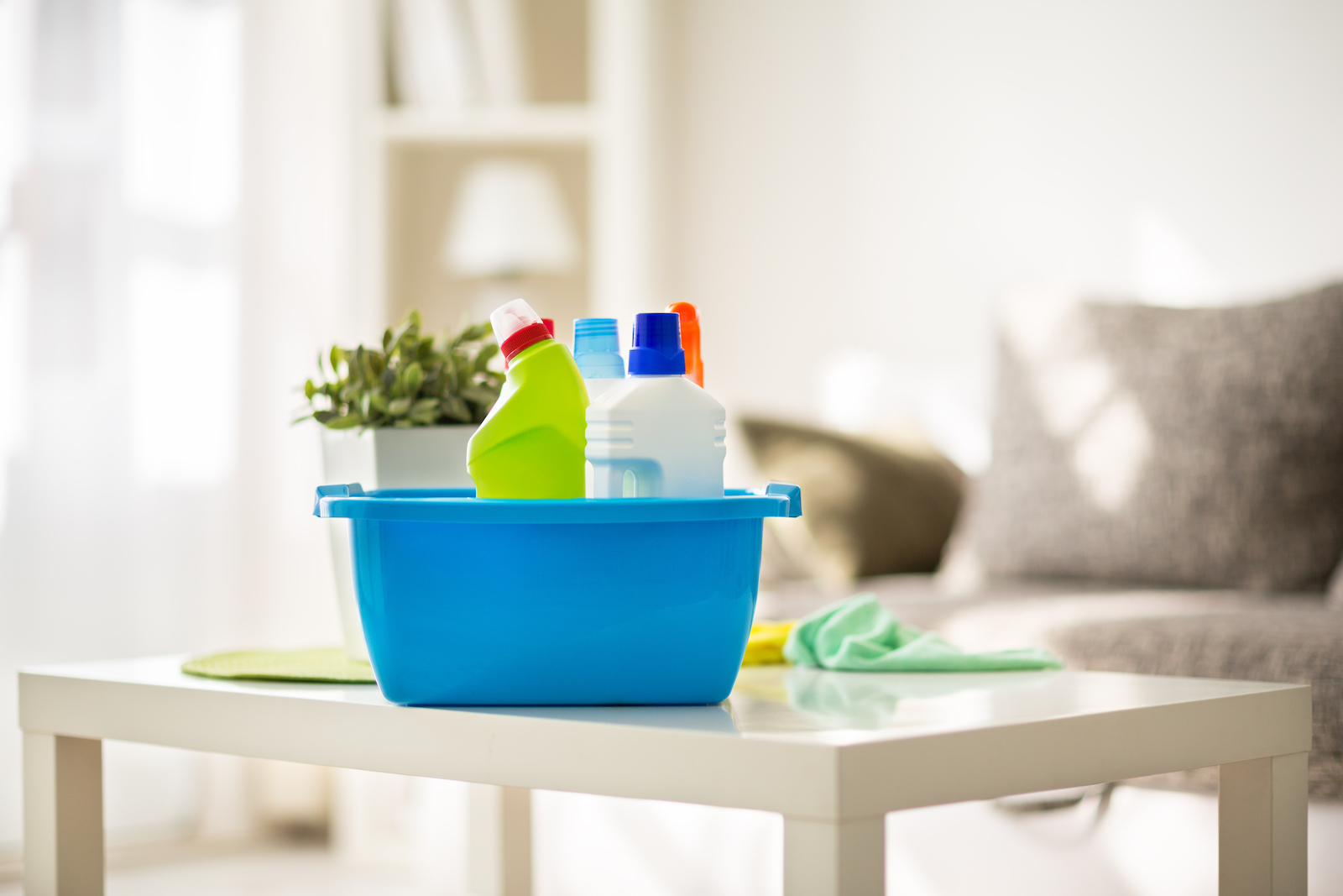bucket of common household cleaners on table