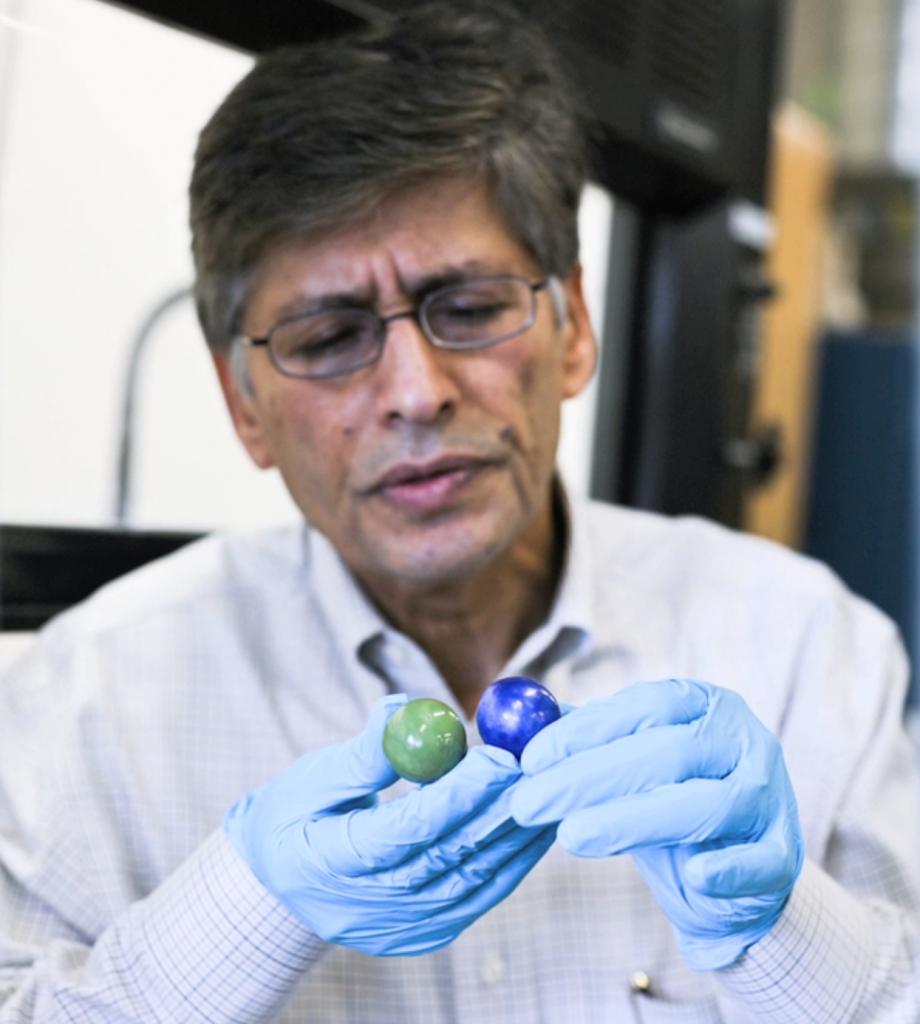Dr. Yogi Goswami holding thermal salt balls in his laboratory at USF