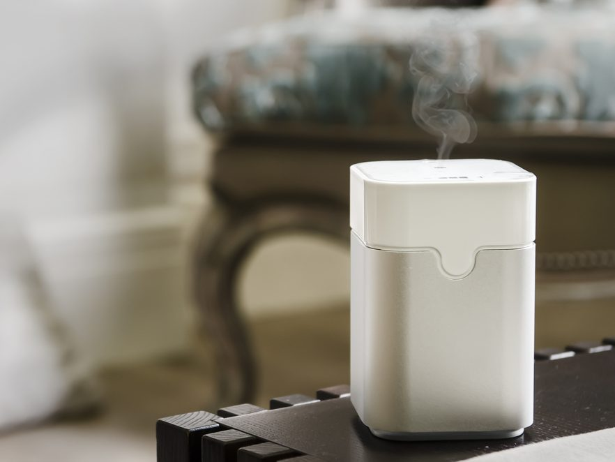 White-colored ultrasonic humidifier atop a table