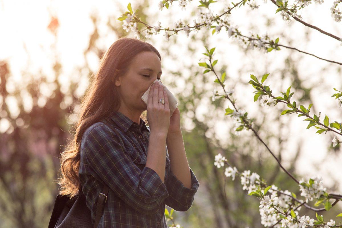 Woman having spring allergy symptoms