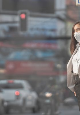 Woman wearing N95 mask for PM 2.5 city air pollution